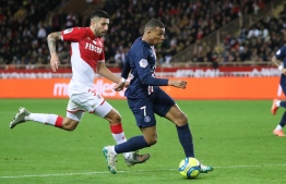 Paris Saint-Germain's French forward Kylian Mbappe (C) runs to score a goal  during the French L1 football match between Monaco (ASM) and Paris Saint-Germain (PSG) at the Louis II Stadium in Monaco on January 15, 2020. (Photo by Valery HACHE / AFP)
