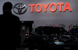 A Toyota automobile logo is pictured during the Brussels  Motor Show on January 9, 2020 in Brussels . (Photo by Kenzo TRIBOUILLARD / AFP)