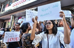 Outraged citizens protest in front of the gender ministry after the Kanduhulhudhoo child sexual abuse case came to light. PHOTO: NISHAN ALI / MIHAARU