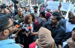 Gender Minister Shidhatha Shareef speaks to the press during a protest sparked by the Kanduhulhudhoo child sexual abuse case; the authorities are under severe fire over failure to ensure the safety of children, with many calling for the minister's resignation. PHOTO: NISHAN ALI / MIHAARU