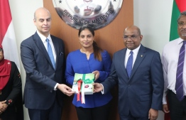 Egyptian Ambassador to Maldives Hussein El Saharty hands over the text books donated through Al-Azhar University to Arabiyya School, which were received by Minister of Education Aishath Ali and Minister of Foreign Affairs Abdulla Shahid. PHOTO/FOREIGN MINISTRY