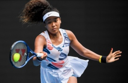Japan's Naomi Osaka hits a return against Czech Republic's Marie Bouzkova during their women's singles match on day one of the Australian Open tennis tournament in Melbourne on January 20, 2020. (Photo by William WEST / AFP) /
