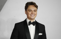 """(FILES) In this file photo taken on December 4, 2019 British actor Dean-Charles Chapman poses on the red carpet as he arrives to attend the World premiere and Royal Film Performance of the film """"1917"""" in London, in support of the film and TV charity. - Universal's war drama """"1917"""" took command of the North American box office this weekend, riding its Golden Globes success to earn an estimated $36.5 million, industry watcher Exhibitor Relations reported on January 12, 2020. The film's unexpectedly strong showing was timely, with Oscar nominations set to be announced on Monday. Last Sunday it won Golden Globes -- often a predictor of Oscar success -- for both best drama and best director (Sam Mendes). (Photo by Tolga AKMEN / AFP)"""