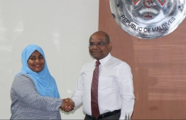 Minister of Foreign Affairs Abdulla Shahid shakes hands with Aminath Shifana, the newly appointed Permanent Secretary. PHOTO: MINISTRY OF FOREIGN AFFAIRS
