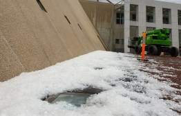"""This handout photo taken and received on January 20, 2020 courtesy of Don Arthur shows hail stones outside the Parliament House in Canberra after a storm. - Thunderstorms and giant hail battered parts of Australia's east coast on January 20 after """"apocalyptic"""" dust storms swept across drought-stricken areas, as extreme weather patterns collided in the bushfire-fatigued country. (Photo by Handout / Courtesy of Don Arthur / AFP) / RESTRICTED TO EDITORIAL USE - MANDATORY CREDIT """"AFP PHOTO / Courtesy of Don Arthur"""" - NO MARKETING NO ADVERTISING CAMPAIGNS - DISTRIBUTED AS A SERVICE TO CLIENTS --- NO ARCHIVE ---"""
