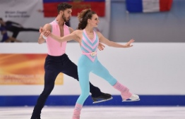 Gabriella Papadakis and Guillaume Cizeron of France perform in the pairs Ice Dance Rhythm Dance event of the ISU European Figure Skating Championships at the Steiermark hall in Graz, Austria, on January 23, 2020. (Photo by Daniel MIHAILESCU / AFP)