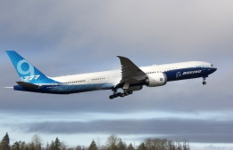 A Boeing 777X airplane takes off on its inaugural flight at Paine Field in Everett, Washington on January 25, 2020. - Boeing's new long-haul 777X airliner made its first flight Saturday, a major step forward for the company whose broader prospects remain clouded by the 737 MAX crisis. The plane took off from a rain-slicked runway a few minutes after 10:00 am local time (1800 GMT), at Paine Field in Everett, Washington, home to Boeing's manufacturing site in the northwestern US. (Photo by Jason Redmond / AFP)