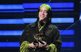"""US singer-songwriter Billie Eilish accepts the award for Song Of The Year for """"Bad Guy"""" during the 62nd Annual Grammy Awards on January 26, 2020, in Los Angeles. PHOTO: ROBYN BECK  / AFP"""
