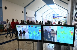 Arriving passengers are seen on screens of a thermal scanner, to check the body temperature, at Bandaranaike International Airport on January 24, 2020, following the coronavirus outbreak in China.  (Photo by LAKRUWAN WANNIARACHCHI / AFP)