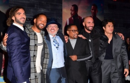 "(FILES) In this file photo taken on January 14, 2020 (L-R) Director Adil El Arbi, actors Will Smith, Joe Pantoliano, Martin Lawrence, director Bilall Fallah and actor Charles Melton arrive for the World Premiere of ""Bad Boys For Life"" at the TCL Chinese theatre in Hollywood. It took Sony 17 years, but the latest ""Bad Boys"" sequel appears to be paying off, taking in an estimated $59.2 million for the start of a US holiday weekend, industry watcher Exhibitor Relations reported on January 19, 2020. ""Bad Boys for Life"" stars Will Smith and Martin Lawrence as wise-cracking detectives who reunite after years apart (""Bad Boys II"" dates from 2003, eight years after the original ""Bad Boys"") to take on a murderous Miami drug cartel.  Frederic J. BROWN / AFP"