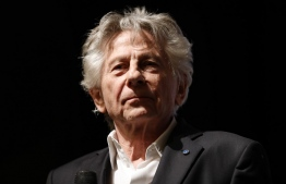 "(FILES) In this file photo taken on November 04, 2019 French Polish director Roman Polanski looks on on stage after the preview of his last movie ""J'accuse"" (An Officer and a Spy) in Paris. - Roman Polanski's new film ""An Officer and a Spy"" topped the list of nominations on Wednesday for the ""French Oscars"", the Cesars. The controversial director has been wanted in the US for the statutory rape of a 13-year-old girl since 1978 and is persona non grata in Hollywood. His period drama about the Dreyfus affair, which rocked France at the turn of the 20th century, is in line for 12 prizes. The head of the French film academy Alain Terzian said it ""should not take moral positions"" about giving awards. (Photo by Thomas SAMSON / AFP)"