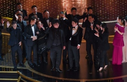 """""""Parasite"""" producers Kwak Sin-ae (L) and Bong Joon-ho (C) accept the award for Best Picture for """"Parasite"""" during the 92nd Oscars at the Dolby Theatre in Hollywood, California on February 9, 2020. (Photo by Mark RALSTON / AFP)"""