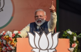 In this photo taken on February 3, 2020, India's Prime Minister and Bharatiya Janata Party (BJP) leader Narendra Modi gestures as he speaks during a rally for the upcoming Delhi state elections in New Delhi. - A diminutive former tax inspector is in the cross-hairs of Indian Prime Minister Narendra Modi's ruling party as it battles to take back power in Delhi's legislative elections on January 8. (Photo by Money SHARMA / AFP)
